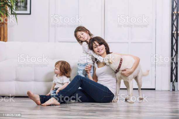 Little kids girls are beautiful and cute with mother and pet dog at picture id1135257338?b=1&k=6&m=1135257338&s=612x612&h=o0obdbh8 xgcwxfztzbj2hzzicvdslsfkeomjvt2qri=