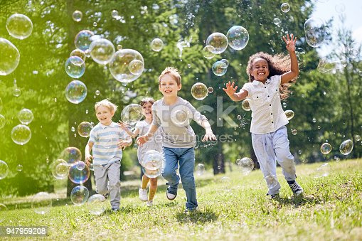 istock Little Kids Having Fun Outdoors 947959208