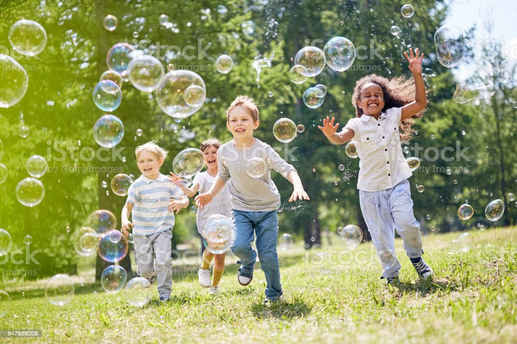 Little Kids Having Fun Outdoors stock photo