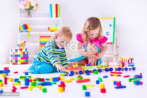 istock Little kids playing at day care 476541544