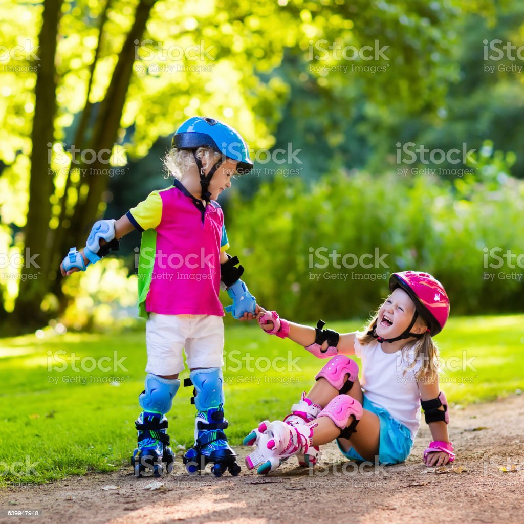 Little Kids Roller Skating In Summer Park Stock Photo Download Image Now Istock