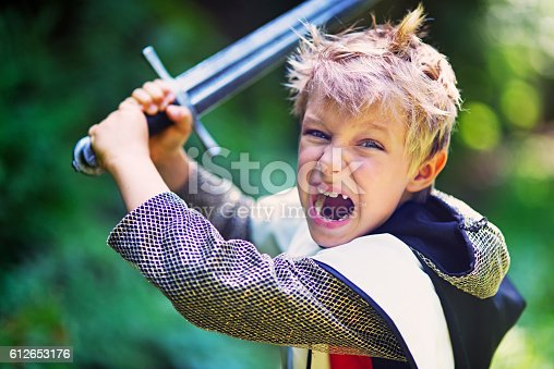 istock Little knight attacking with sword 612653176
