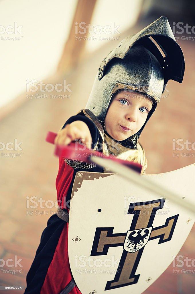 Little knight fighting stock photo