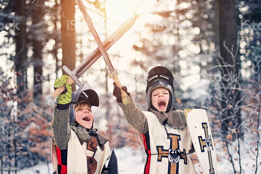 Little knights victory in frozen forest stock photo