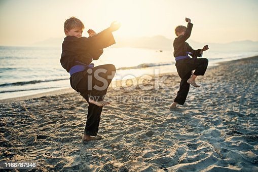 Two kids practicing kung fu on the beach. Nikon D850