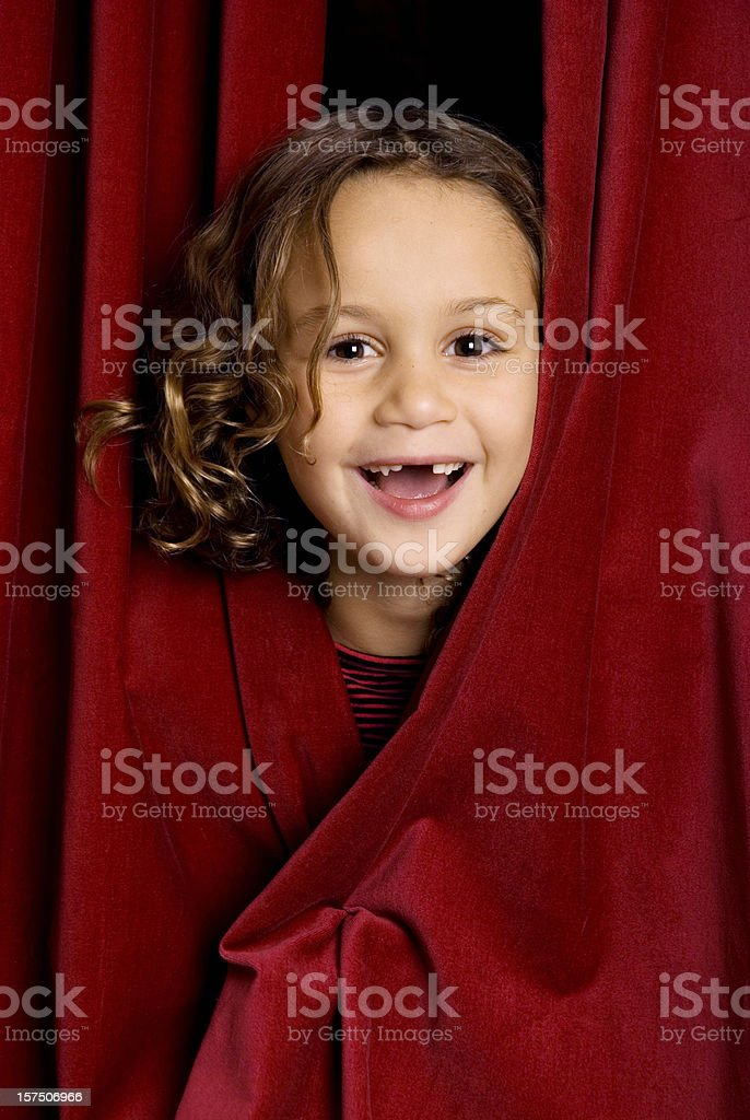 Little laughing performer stock photo