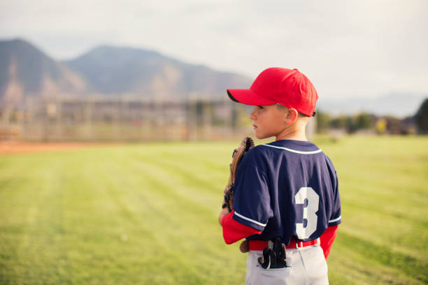 little league baseball boy profile - baseball sport stock photos and pictures