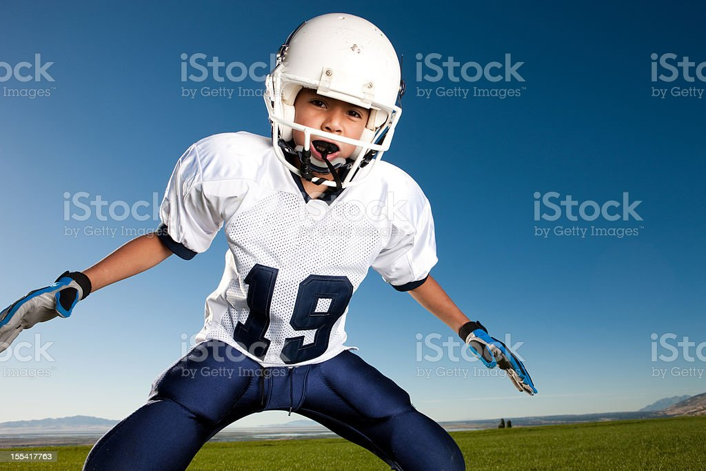 Little League Football Player Ready to Tackle stock photo