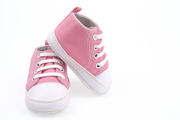 little light pink shoes for babies - its a girl stock photos and pictures