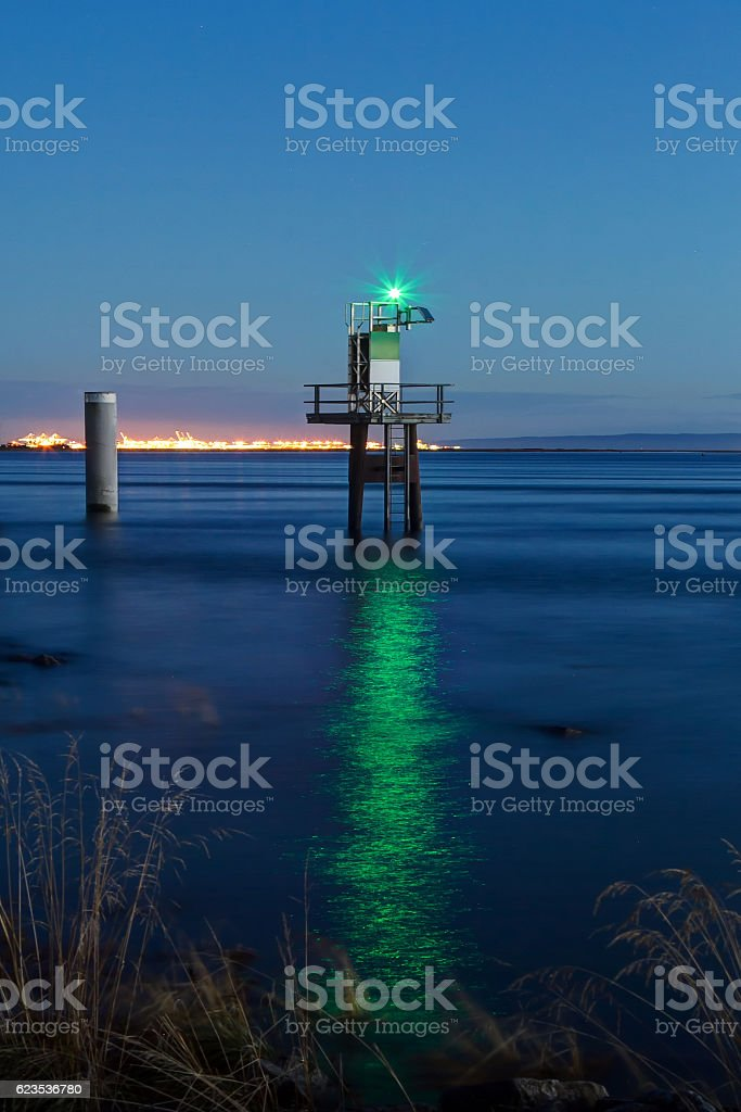 little lighthouse with green light stock photo