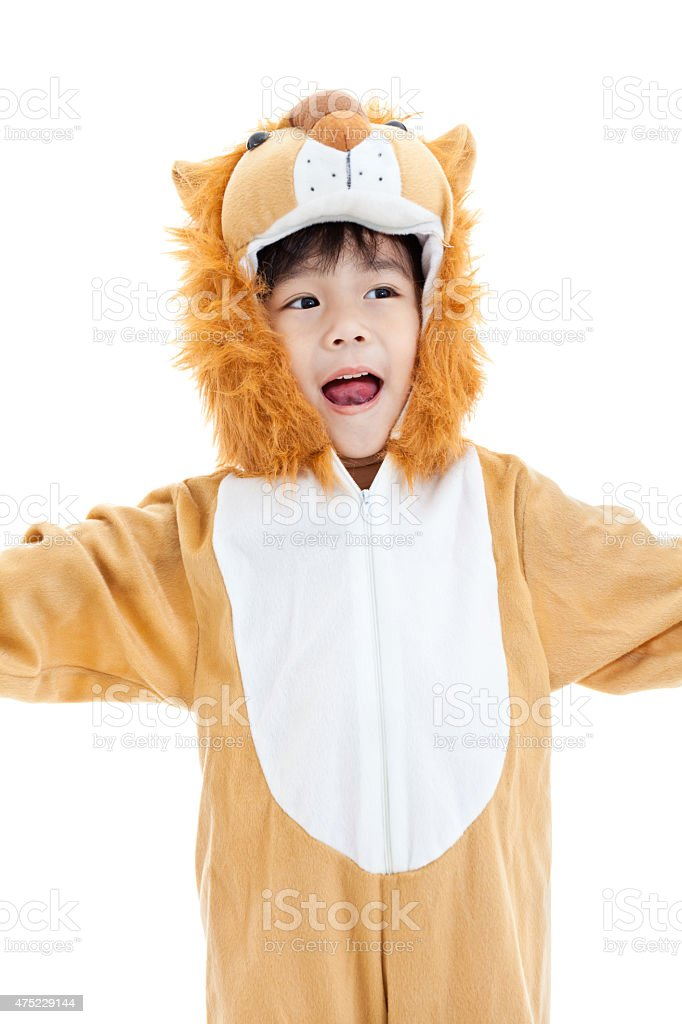Little lovely asian boy costumed like lion and looking ahead stock photo
