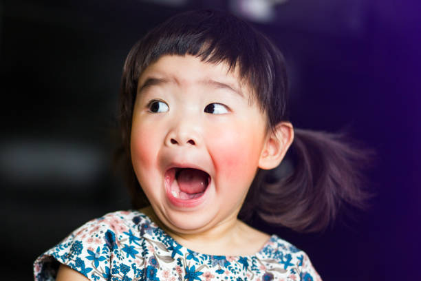 a little lovely asian girl feels shocked and open mouth wide - fear stock photos and pictures