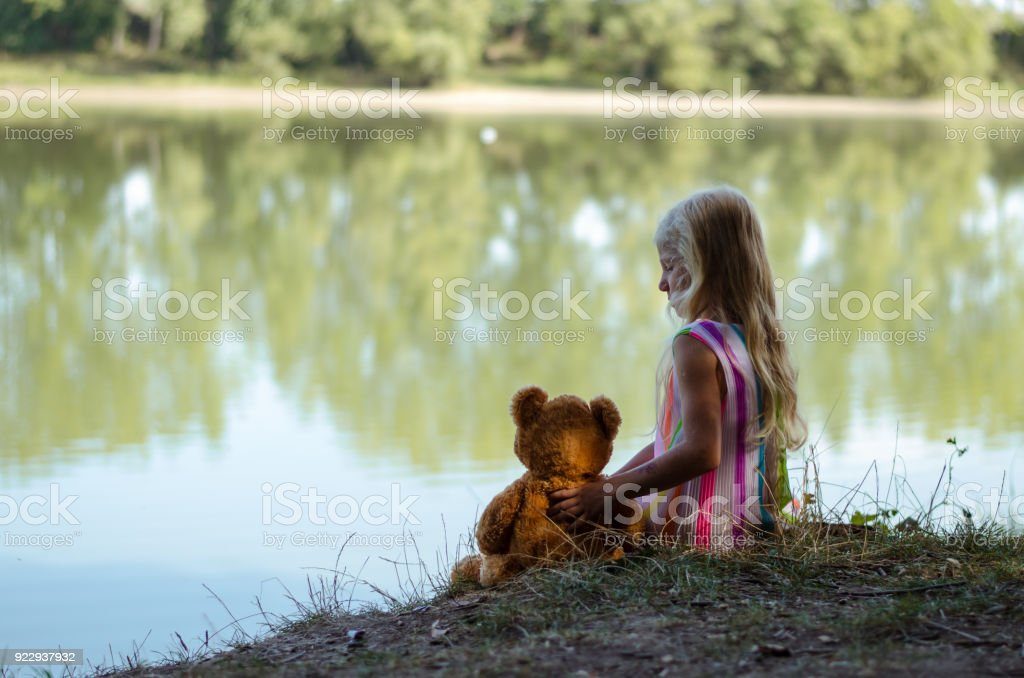 little lovely blond girl in the nature stock photo