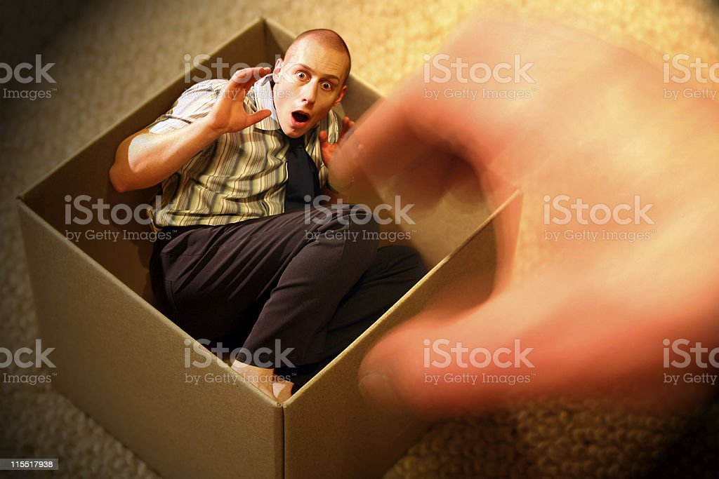 Little Man Trapped in a Box royalty-free stock photo