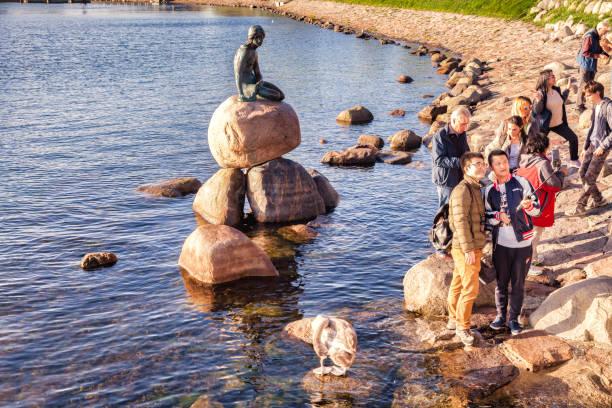 Little Mermaid and Tourists, Copenhagen, Denmark stock photo