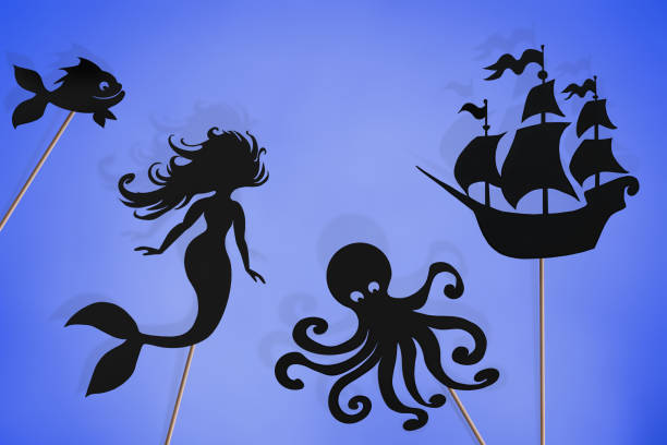 little mermaid storytelling, shadow puppets of sea creatures. - vintage nautical stock photos and pictures