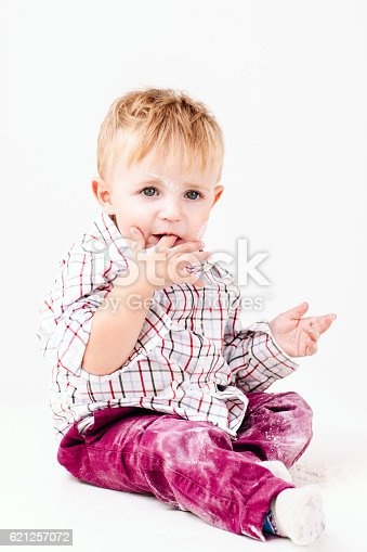 istock Little messy with flour boy on white background 621257072