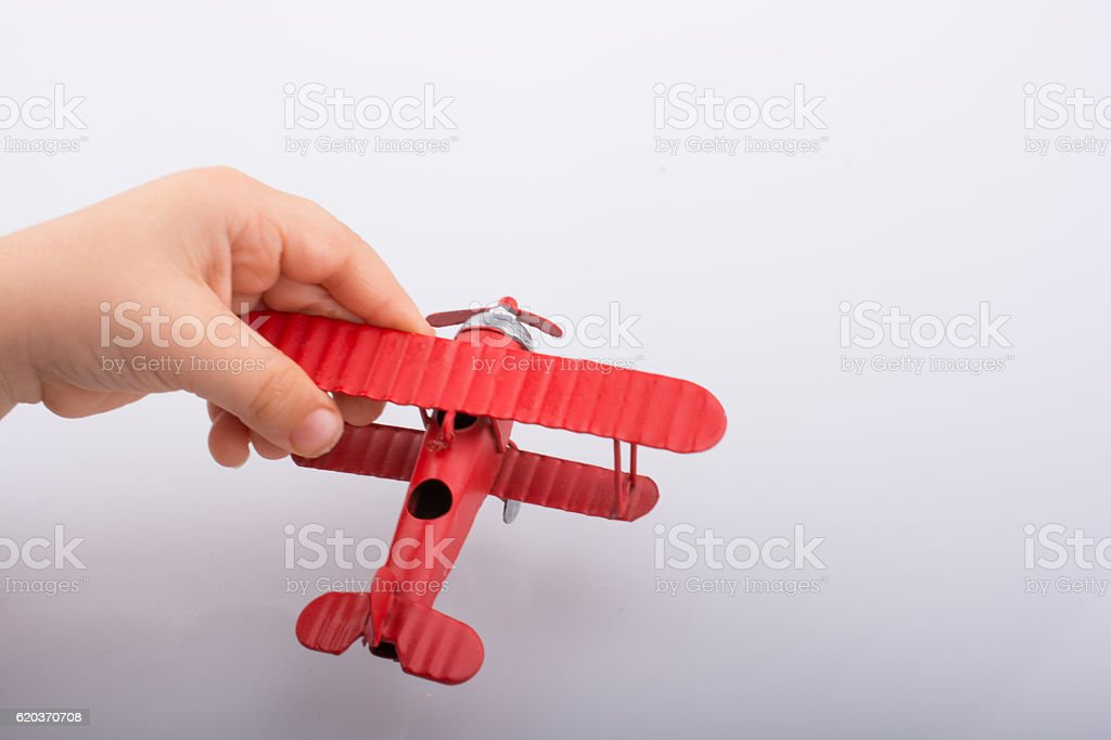Little metal model airplane in child hand zbiór zdjęć royalty-free