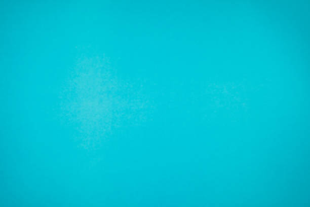 a little mottled bright blue turquoise paper plain and solid for minimal object background. - solidità foto e immagini stock