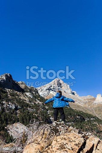 istock Little mountaineer on the peak of the mountains 1090201130