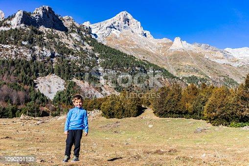 istock Little mountaineer on the peak of the mountains 1090201132