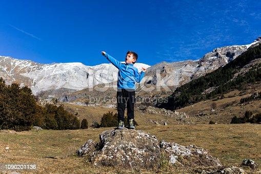 istock Little mountaineer on the peak of the mountains 1090201136