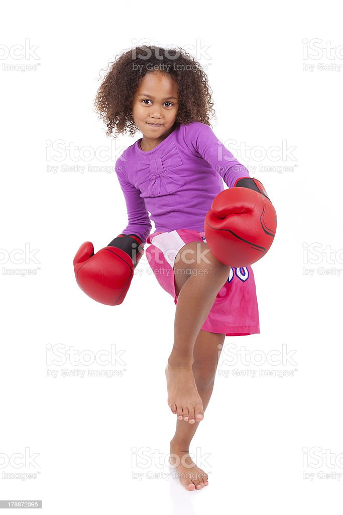Little muay thai boxing girl using her knee royalty-free stock photo