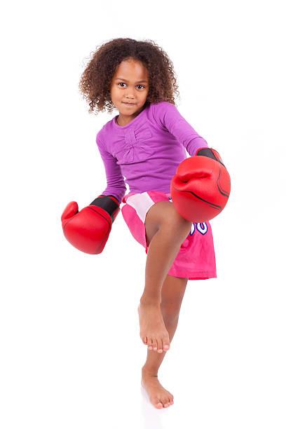 Little muay thai boxing girl using her knee stock photo