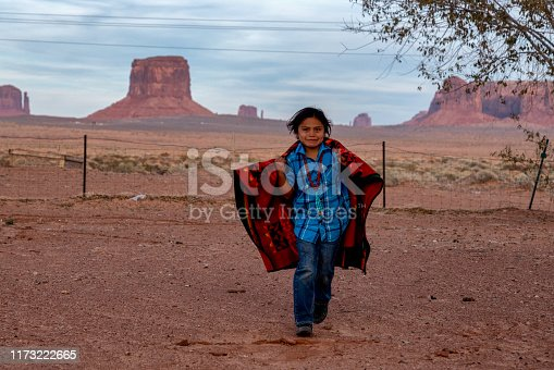 Little Navajo Boy in his yard on the Navajo Indian Reservation in Monument Valley Arizona