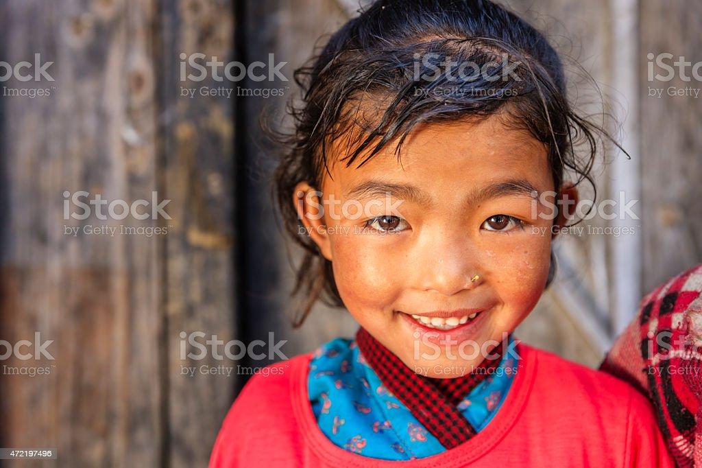 Little Nepali girl in village near Annpurna Range, Nepal stock photo