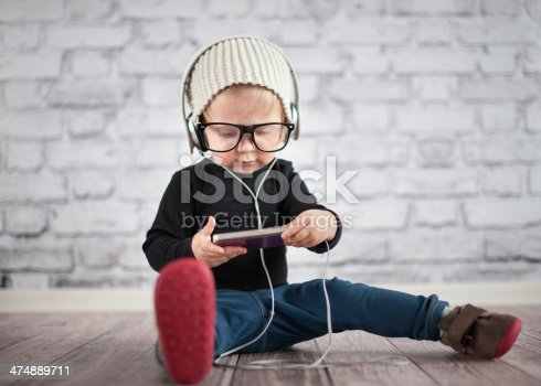 istock Little nerd with music player 474889711