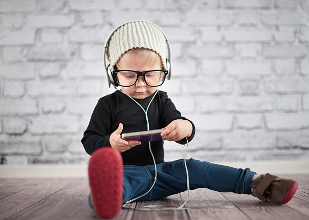 Little nerd with music player Little nerd with music player digital native stock pictures, royalty-free photos & images