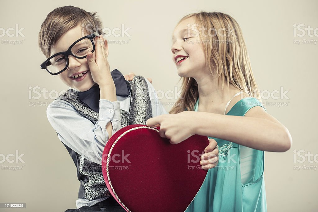 Little Nerdy Boy and Girl on Valentine's Day royalty-free stock photo