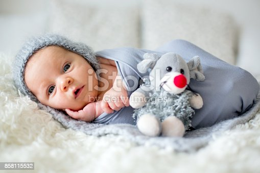 istock Little newborn baby boy, looking curiously at camera 858115532