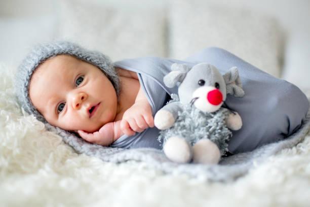Little newborn baby boy looking curiously at camera picture id858115532?b=1&k=6&m=858115532&s=612x612&w=0&h=7kr2mf04lev0frvcro6vc3u75pfikskypo2qjivpne4=