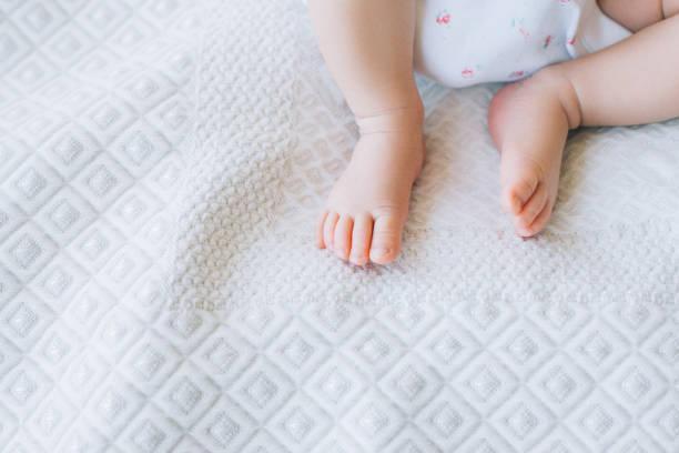 little newborn baby feet on white background stock photo