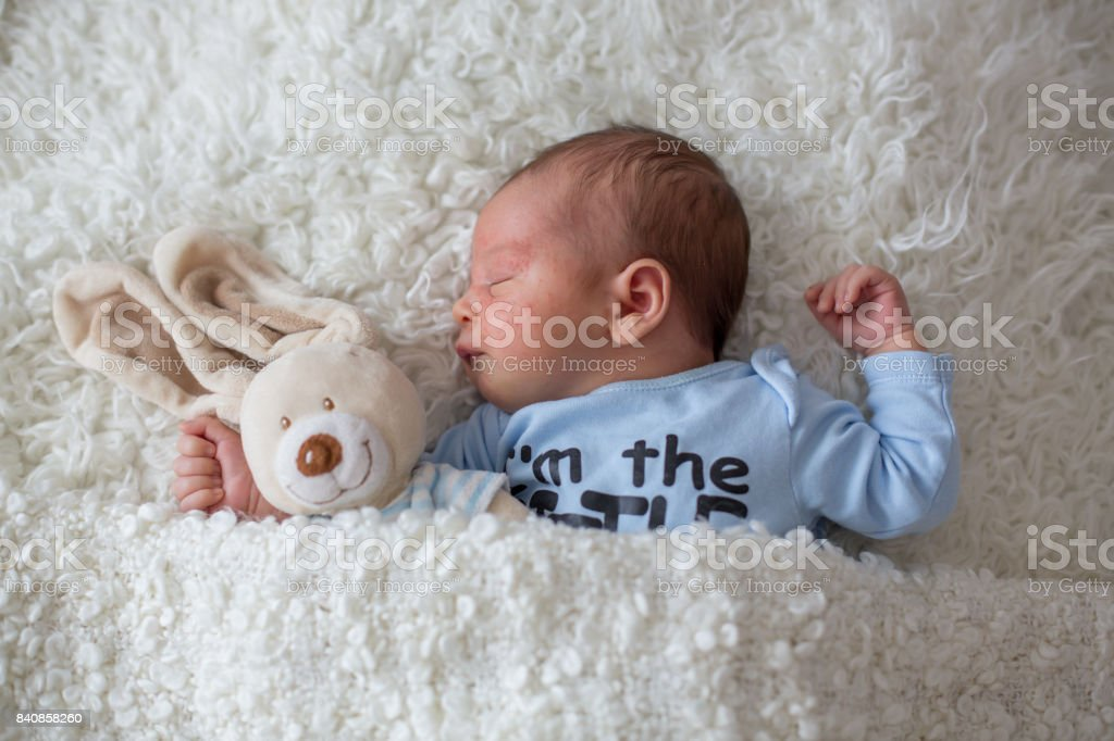 Little newborn baby sleeping, baby with scin rash stock photo