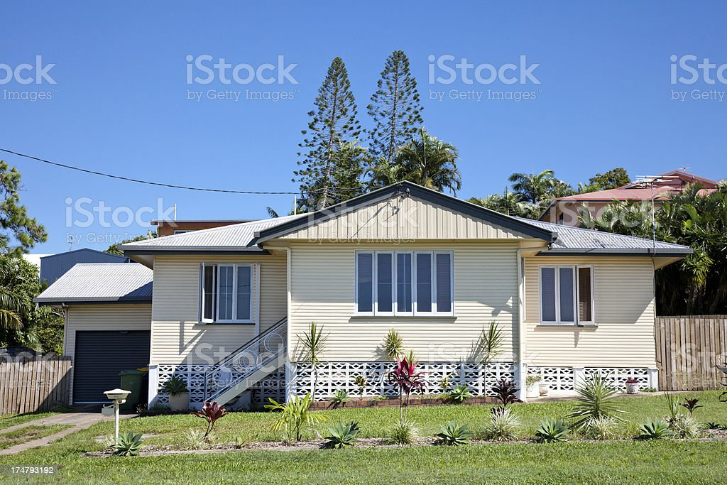 Little Old Style Home with blue sky stock photo