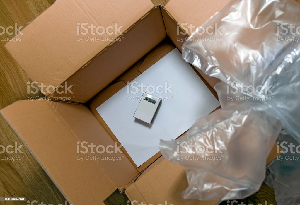 packing by large card box and air cushions for a little packet