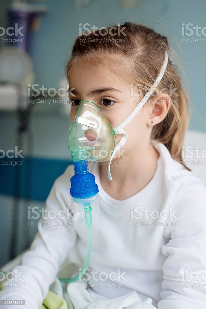 Little patient with the nebuliser stock photo
