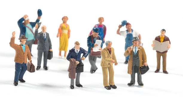 little people on white background - figurine stock photos and pictures