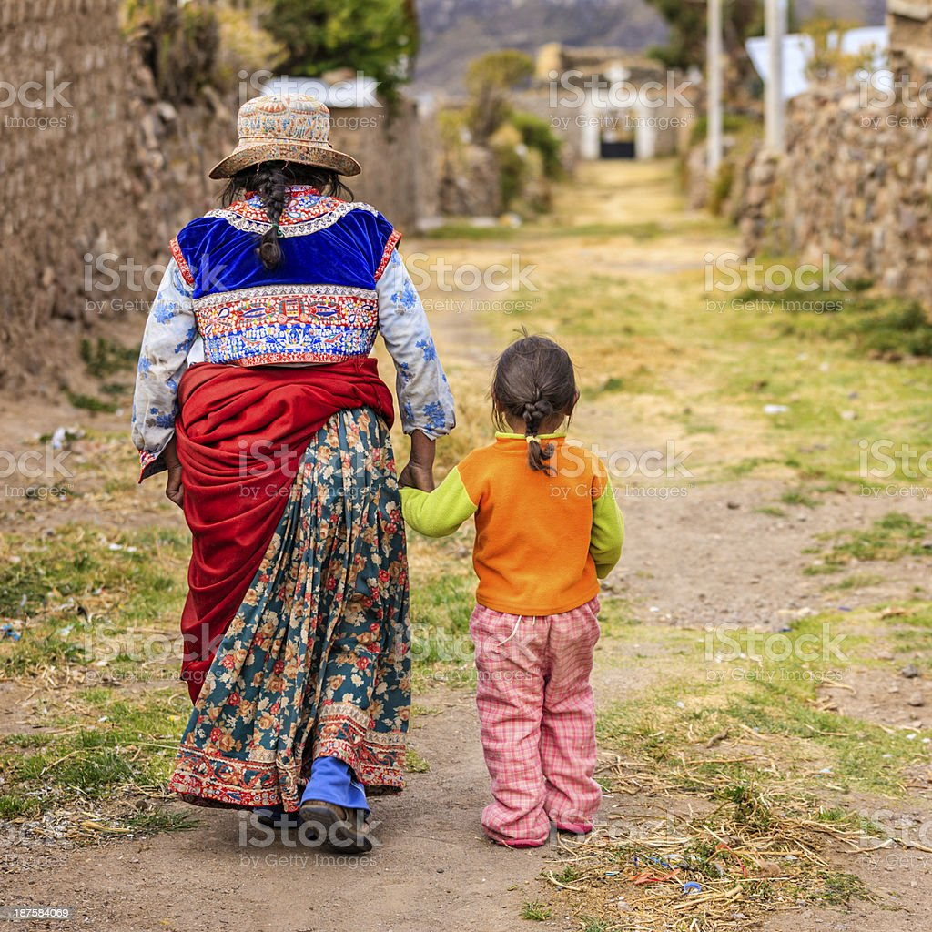 Little Peruvian girl with her mother, Canion Colca, Arequipa, Peru stock photo