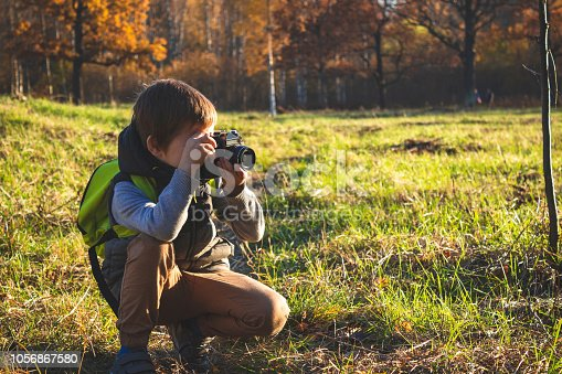 istock little photographer in the Park 1056867580