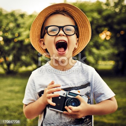 Happy little photographer with vintage camera