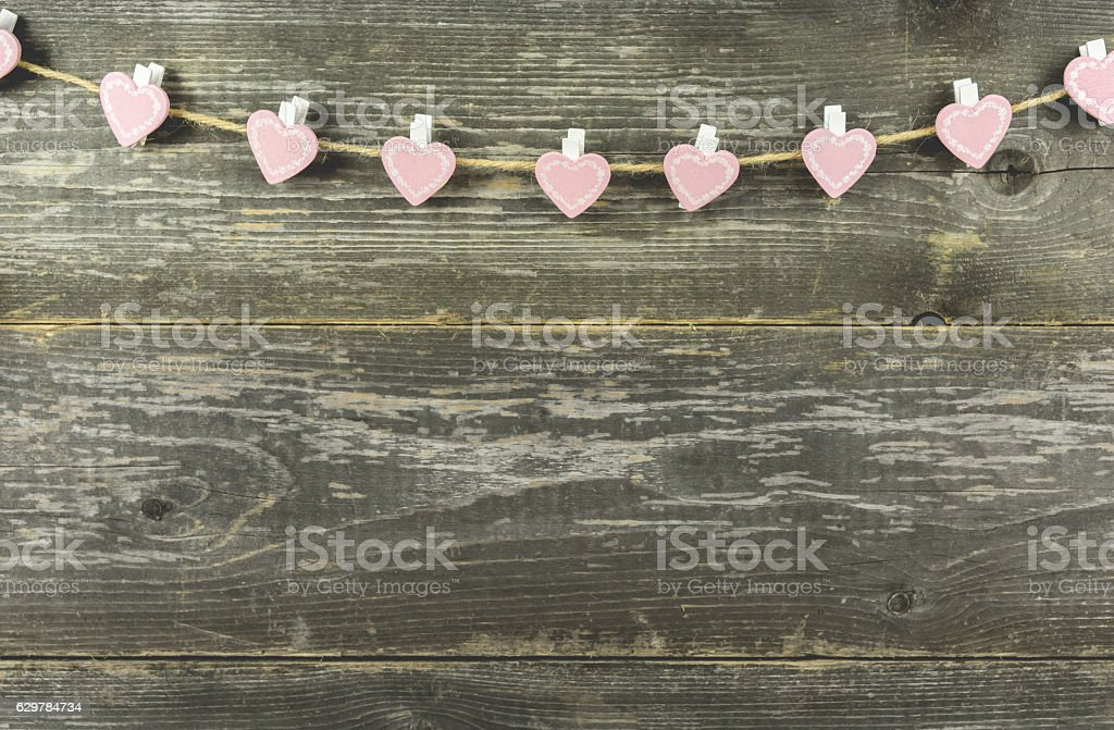 Little Pink Hearts with Wooden Background stock photo