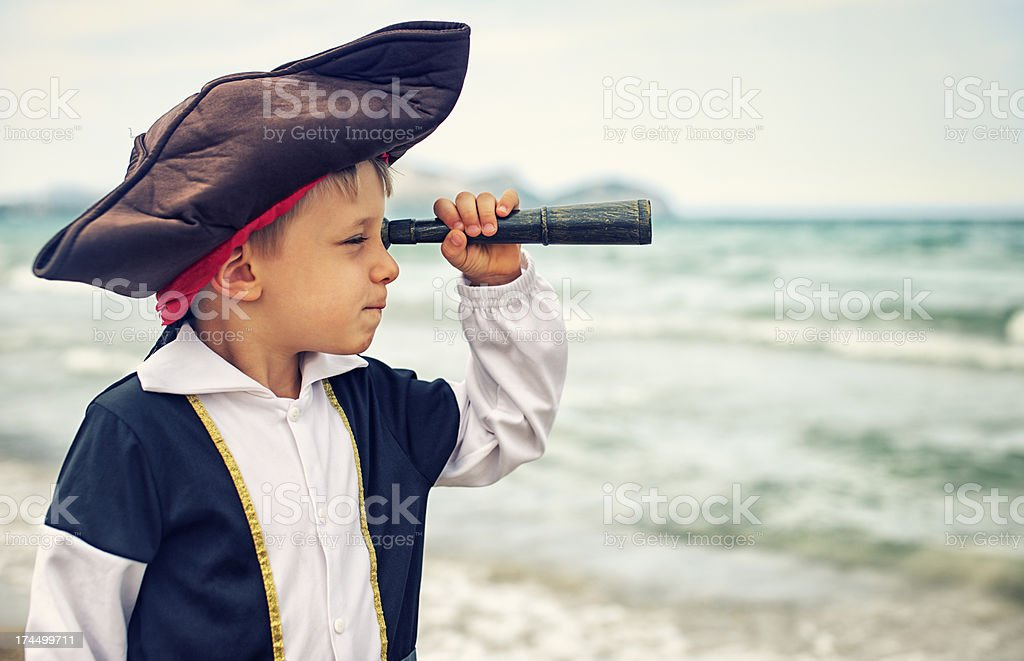 Little pirate looking with spyglass royalty-free stock photo