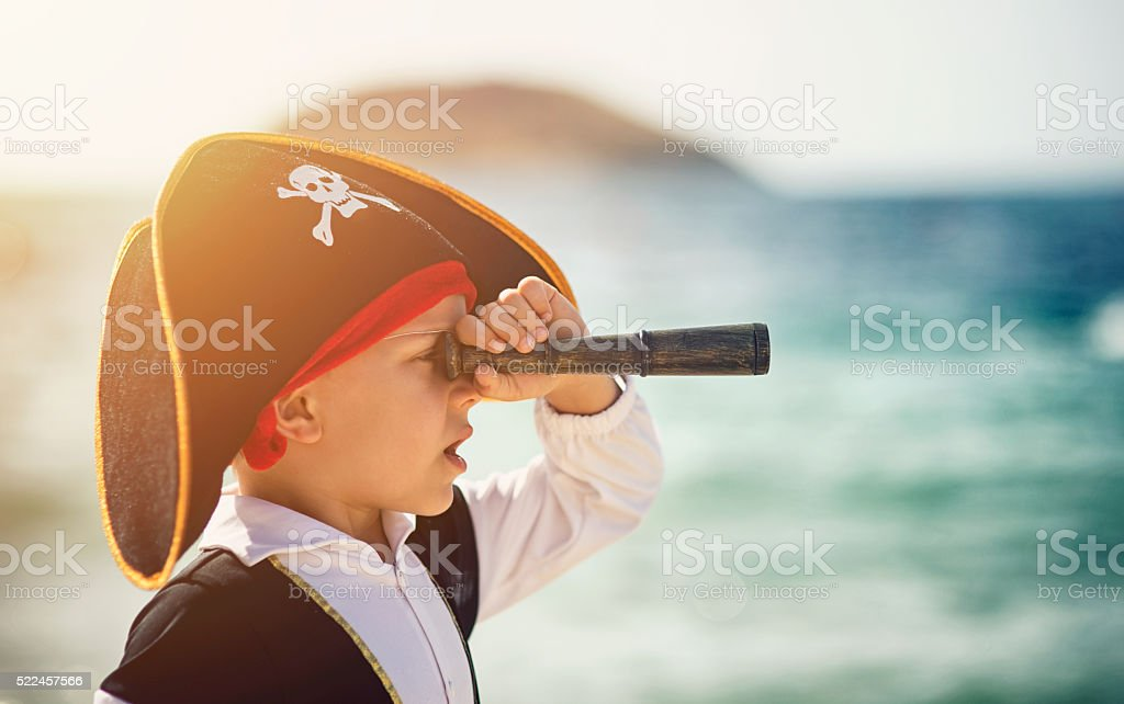 Little pirate looking with spyglass stock photo