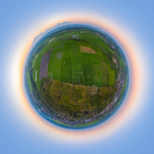 Little planet 360 degree sphere. Panorama of aerial top view of Paddy rice, agricultural fields in countryside or rural area of Bali, mountain hills valley on summer. Indonesia. Nature landscape. stock photo