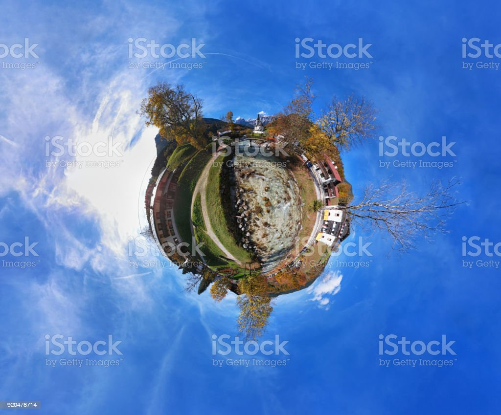 Little planet aerial panorama of Parish church St. Sebastian at autumn, in Ramsau, Berchtesgaden, Bavarian Alps, Germany stock photo