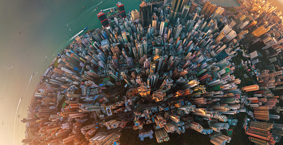 istock Little planet. Aerial view of Hong Kong Downtown. Financial district and business centers in smart city in Asia. Top view. Panorama of skyscraper and high-rise buildings. 1044815792